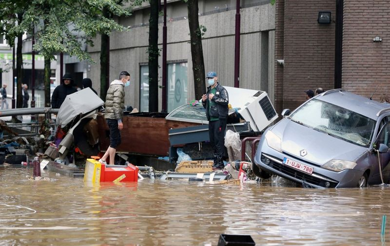 A picture taken on July 15, 2021 shows damaged cars on a flooded street in the Belgian city of Verviers, after heavy rains and floods lashed western Europe, killing at least two people in Belgium. (Photo by François WALSCHAERTS / AFP)