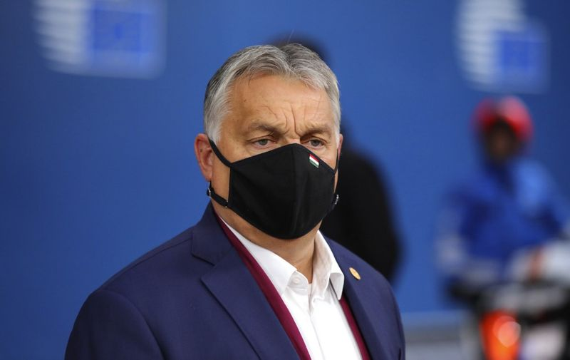 Hungary's Prime Minister Viktor Orban arrives on the second day of a European Union (EU) summit at The European Council Building in Brussels on October 2, 2020. - During this Special European Council, EU leaders will discuss foreign affairs, in particular relations with Turkey and the situation in the Eastern Mediterranean. (Photo by Olivier Matthys / POOL / AFP)