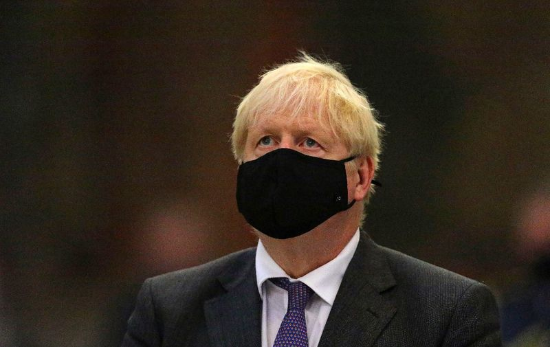 Britain's Prime Minister Boris Johnson wearing a protective face covering, attends a service marking the 80th anniversary of the Battle of Britain at Westminster Abbey in central London on September 20, 2020. - Westminster Abbey has played a central role in remembering the sacrifice of those who fought in the battle, holding a Service of Thanksgiving and Rededication on Battle of Britain Sunday every year since 1944. (Photo by Aaron Chown / POOL / AFP)