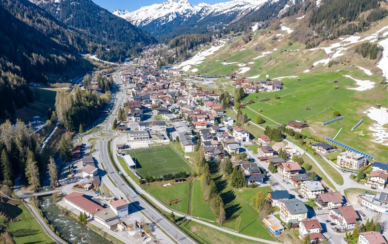 General aerial view taken on April 23, 2020 shows the village and ski resort of St Anton am Arlberg in Tyrol, Austria, close to Ischgl and the Paznauntal valley, amid the new coronavirus COVID-19 pandemic. - In Europe, several countries including Austria have begun to relax restrictions while still calling for the public to practice social distancing. (Photo by Johann GRODER / various sources / AFP) / Austria OUT