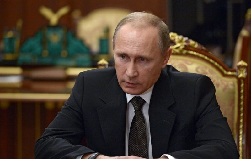 Russian President Vladimir Putin chairs a meeting with security chiefs on the results of the investigation into the Russian MetroJet Airbus A321 crash at the Kremlin in Moscow early on November 17, 2015. Russian President Vladimir Putin pledged to step up air strikes in Syria after Moscow confirmed a bomb brought down a Russian passenger jet in Egypt last month, the Kremlin said on November 17. AFP PHOTO / SPUTNIK / ALEXEI NIKOLSKY / AFP / SPUTNIK / ALEXEI NIKOLSKY