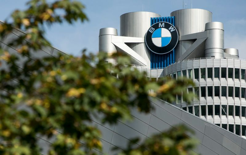 A logo sign outside of the headquarters of the BMW Group (Bayerische Motoren Werke) in Munich, Germany, on September 9, 2018.,Image: 387976411, License: Rights-managed, Restrictions: , Model Release: no