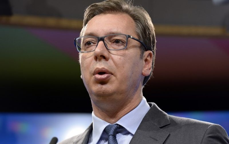 Serbia's President Aleksandar Vucic addresses media representative following his meeting at the European Union Council in Brussels on July 14, 2017. / AFP PHOTO / THIERRY CHARLIER