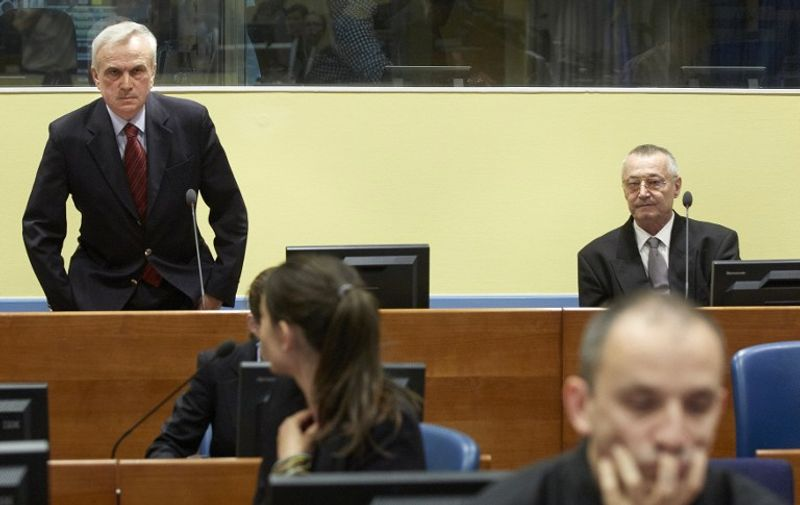 Serbia's former secret police chief Jovica Stanisic (L) and his former deputy Franko Simatovic (R) sit in the court prior to the trial chamber judgement hearing at the International Criminal Tribunal for the former Yugoslavia (ICTY) in The Hague on May 30, 2013. A UN tribunal on Thursday acquitted Serbian ex-intelligence chief Jovica Stanisic and his deputy of running Bosnian death squads during ex-Yugoslavia's brutal 1990s conflict, saying prosecutors did not prove their involvement beyond reasonable doubt.  AFP PHOTO / ANP POOL MARTIJN BEEKMAN   netherlands out - belgium out / AFP / Martijn Beekman