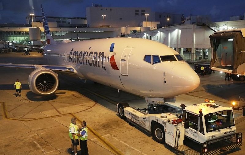 MIAMI, FL - MARCH 13: A grounded American Airlines Boeing 737 Max 8 is towed to another location at Miami International Airport on March 13, 2019 in Miami, Florida. American Airlines is reported to say that it will ground its fleet of 24 Boeing 737 Max planes and it plans to rebook passengers after the Federal Aviation Administration grounded the entire United States Boeing 737 Max fleet.   Joe Raedle/Getty Images/AFP
