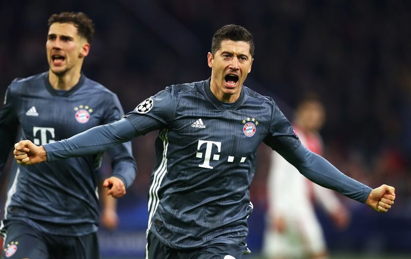 AMSTERDAM, NETHERLANDS - DECEMBER 12:  Robert Lewandowski of Bayern Muenchen celebrates scoring his teams second goal of the game during the UEFA Champions League Group E match between Ajax and FC Bayern Munich at Johan Cruyff Arena on December 12, 2018 in Amsterdam, Netherlands.  (Photo by Dean Mouhtaropoulos/Getty Images)