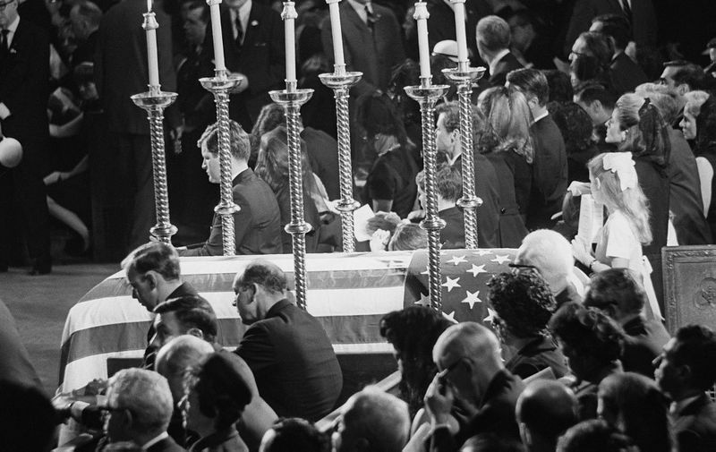 His relatives surround Senator Robert F. Kennedy's coffin in Saint Patrick cathedral in New York 08 June 1968. Bob Kennedy who was shot in the head 5 June at the Ambassador Hotel of Los Angeles will be buried next to his brother John F. Kennedy at the Arlington cemetery. (Photo by AFP)