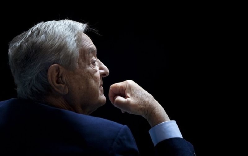 """George Soros, Chairman of Soros Fund Management, listens during a seminar titled """"Charting A New Growth Path for the Euro Zone"""" at the annual International Monetary Fund and World Bank meetings September 24, 2011 in Washington, DC.  AFP PHOTO/Brendan SMIALOWSKI / AFP PHOTO / BRENDAN SMIALOWSKI"""
