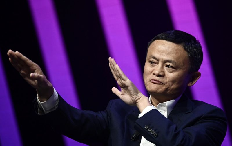 Jack Ma, CEO of Chinese e-commerce giant Alibaba, gestures as he speaks during his visit at the Vivatech startups and innovation fair, in Paris on May 16, 2019. (Photo by Philippe LOPEZ / AFP)