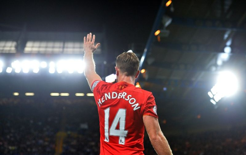 Liverpool's English midfielder Jordan Henderson waves to the fans following the English Premier League football match between Chelsea and Liverpool at Stamford Bridge in London on September 16, 2016. Liverpool won the match 2-1. / AFP PHOTO / GLYN KIRK / RESTRICTED TO EDITORIAL USE. No use with unauthorized audio, video, data, fixture lists, club/league logos or 'live' services. Online in-match use limited to 75 images, no video emulation. No use in betting, games or single club/league/player publications.  /