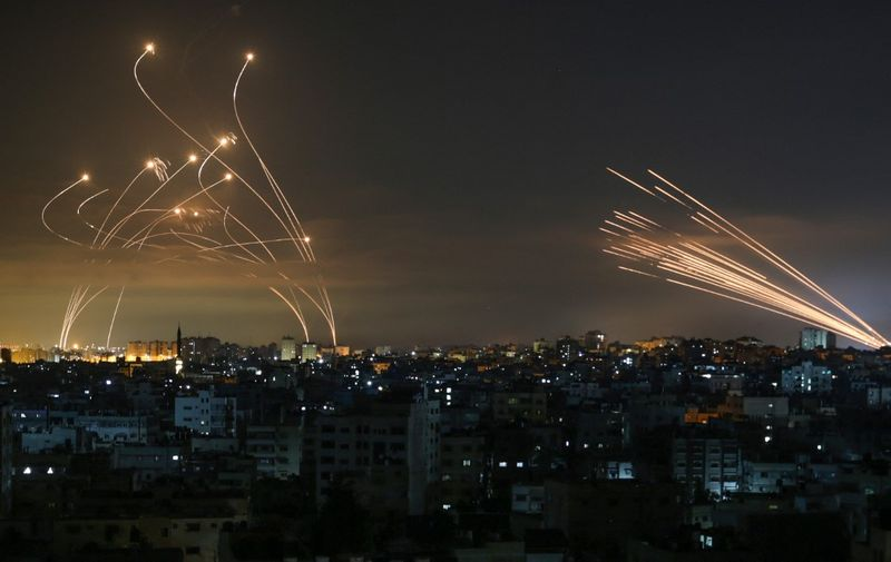 "Rockets are seen in the night sky fired towards Israel from Beit Lahia in the northern Gaza Strip on May 14, 2021. - Israel bombarded Gaza with artillery and air strikes on Friday, May 14, in response to a new barrage of rocket fire from the Hamas-run enclave, but stopped short of a ground offensive in the conflict that has now claimed more than 100 Palestinian lives. As the violence intensified, Israel said it was carrying out an attack ""in the Gaza Strip"" although it later clarified there were no boots on the ground. (Photo by ANAS BABA / AFP)"