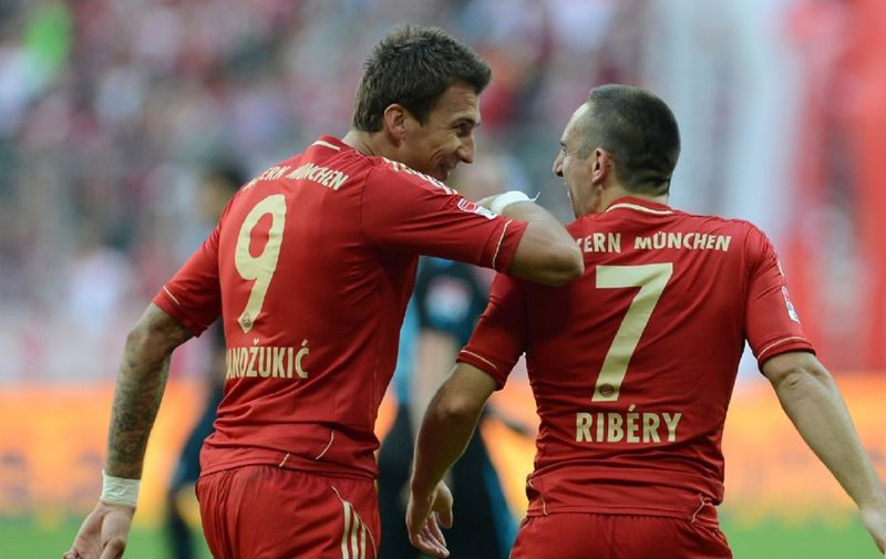Bayern Munich's Croatian striker Mario Mandzukic (L) and Bayern Munich's French midfielder Franck Ribery celebrate after the second goal during the German first division Bundesliga match between Bayern Munich and TSG 1899 Hoffenheim in Munich, southern Germany, on October 6, 2012. AFP PHOTO/CHRISTOF STACHE  DFL RULES TO LIMIT THE ONLINE USAGE DURING MATCH TIME TO 15 PICTURES PER MATCH. IMAGE SEQUENCES TO SIMULATE VIDEO IS NOT ALLOWED AT ANY TIME. FOR FURTHER QUERIES PLEASE CONTACT THE DFL DIRECTLY AT + 49 69 650050. (Photo by CHRISTOF STACHE / AFP)