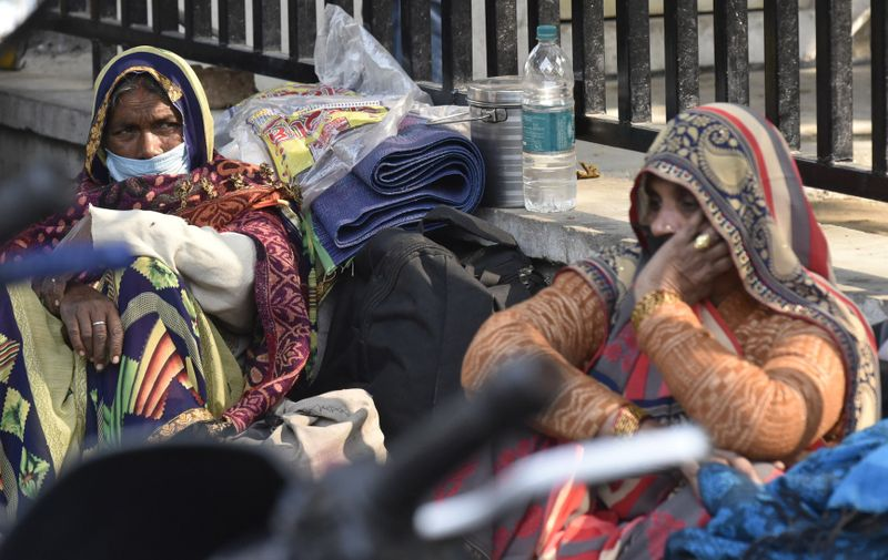 People waiting outside the Trauma Centre at KGMU Hospital, on November 23, 2020 in Lucknow, India. Daily Life Amid Coronavirus Pandemic In India, Lucknow, Uttar Pradesh - 23 Nov 2020,Image: 570877779, License: Rights-managed, Restrictions: , Model Release: no