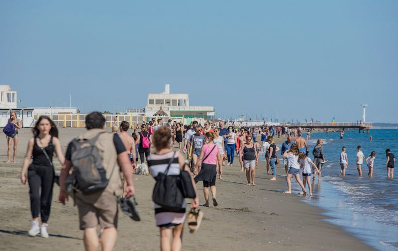 "Coronavirus ""phase 2"": a lot of people walk on the beach of Ostia, in the south district of Rome, Italy. Rome: Ready for the summer, Rome, Italy, Italy - 23 May 2020,Image: 521808016, License: Rights-managed, Restrictions: , Model Release: no, Credit line: Profimedia"