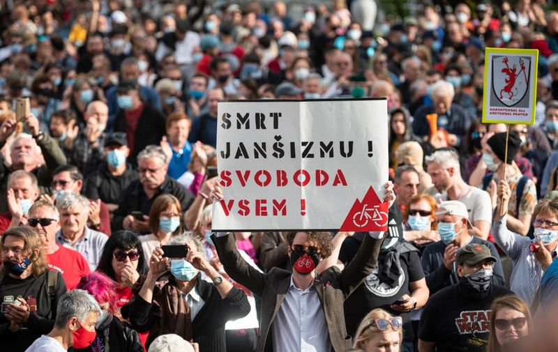 People take part in an anti-government protest in Ljubljana on May 28, 2021. (Photo by Jure Makovec / AFP)