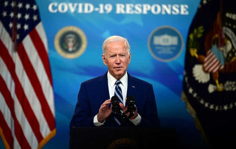 US President Joe Biden with Vice President Kamala Harris (not shown), delivers remarks on Covid-19 response and vaccinations in the South Court Auditorium of the White House in Washington DC, on March 29, 2021. - US President Joe Biden's administration on March 29, 2021 announced a set of new actions to ensure that 90 percent of adults will be eligible for vaccination against Covid by April 19. (Photo by JIM WATSON / AFP)