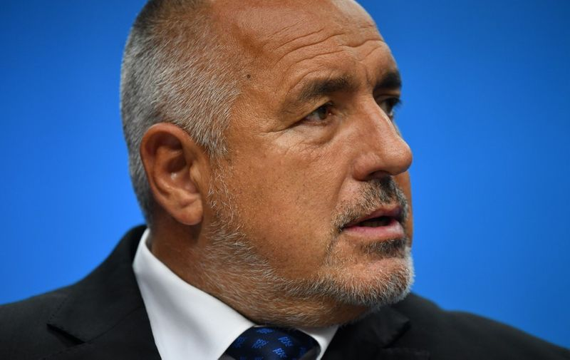 """Bulgaria's Prime Minister Boyko Borisov looks on as he gives a joint press conference with President of the European Commission and European Council President on the sidelines of an European Union leaders' summit, without Britain, to discuss Brexit and eurozone reforms on June 29, 2018 at the Europa building in Brussels. - EU leaders clinched a hard-won migration deal during all-night talks on June 29, that Italy's hardline new premier said meant his country was """"no longer alone"""" in shouldering the responsibility for migrants. (Photo by Ben STANSALL / AFP)"""