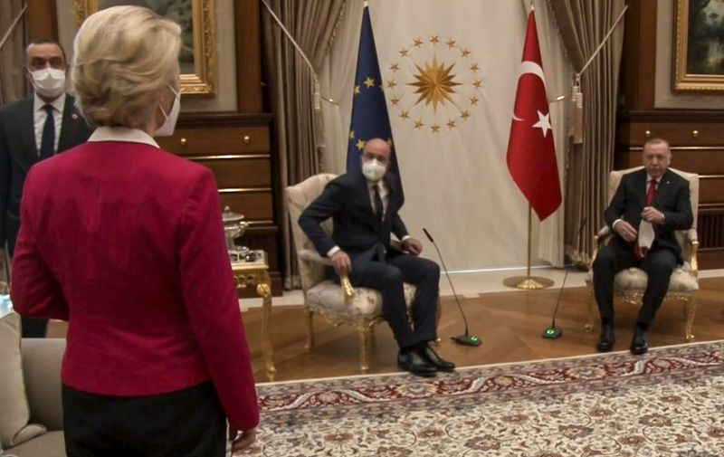 "This video frame grab taken from footage released by The Turkish Presidency on April 6, 2021, shows Turkish President Recep Tayyip Erdogan (R) receiving EU Council President Charles Michel (C) and President of EU Commission Ursula von der Leyen (L) at the Presidential Complex in Ankara. - The European Commission hit out April 7, 2021, at a diplomatic snub that left its head Ursula von der Leyen without a chair as male counterparts sat down at a meeting with Turkish President Recep Tayyip Erdogan. Video from the April 6, 2021, encounter in Ankara showed von der Leyen flummoxed as the Turkish leader and European Council president Charles Michel took the only two chairs in front of their flags. (Photo by - / various sources / AFP) / RESTRICTED TO EDITORIAL USE - MANDATORY CREDIT ""AFP PHOTO /TURKISH PRESIDENTIAL PRESS SERVICE "" - NO MARKETING - NO ADVERTISING CAMPAIGNS - DISTRIBUTED AS A SERVICE TO CLIENTS"