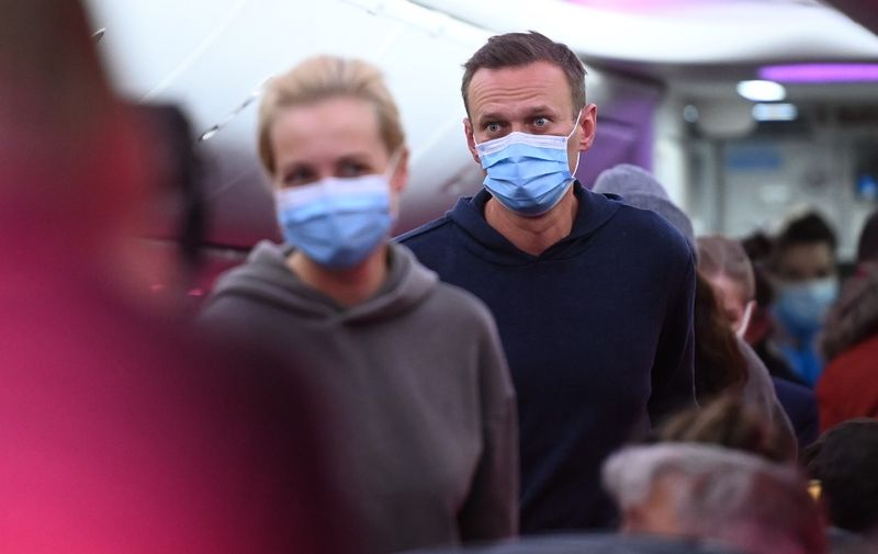 Russian opposition leader Alexei Navalny and his wife Yulia are seen in a Pobeda plane heading from Berlin to Moscow on January 17, 2021. - Chief Kremlin critic Alexei Navalny returns to Russia from Germany on January 17, facing imminent arrest after authorities warned they would detain him. The 44-year-old opposition leader is flying back to Moscow after spending several months in Germany recovering from a poisoning attack that he said was carried out on the orders of President Vladimir Putin. (Photo by Kirill KUDRYAVTSEV / AFP)