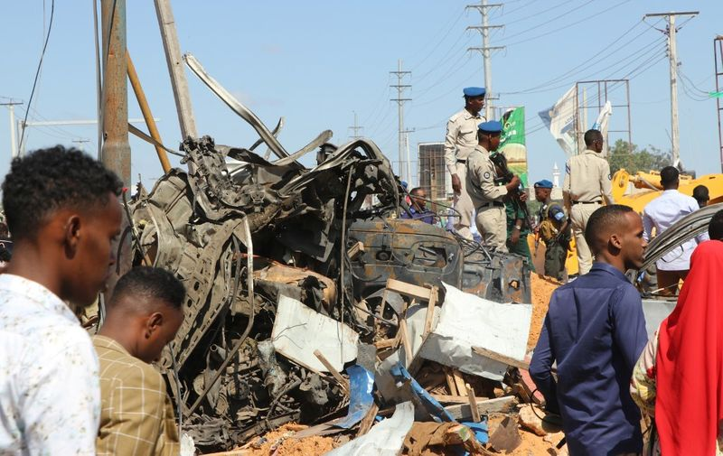 The wreckage of a car that was destroyed during the car bomb that exploded in Mogadishu that killed more than 20 people is photographed in Mogadishu on December 28, 2019. - A massive car bomb exploded in a busy area of the Somali capital Mogadishu on December 28, 2019, leaving more than 20 people dead. (Photo by Abdirazak Hussein FARAH / AFP)